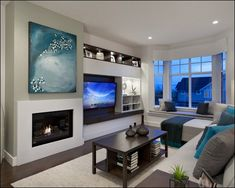Love this wall, fire place, TV and storage. Just the fire place frame looks…