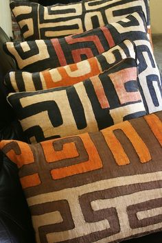 of a Kind Cream Freeform on Black Congo Raffia Pillows with Inserts African Kuba Cloth Pillows bring natural beauty and rich color to your home. Sold on .African Kuba Cloth Pillows bring natural beauty and rich color to your home. Sold on . African Interior Design, African Design, African Textiles, African Fabric, African Prints, Handmade Home Decor, Diy Home Decor, Ethno Design, African Theme
