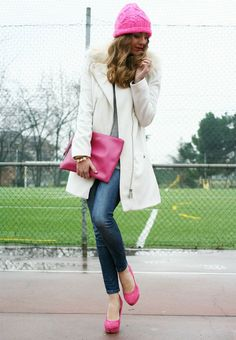 Contrast a classic cream coat with bright accessories.