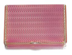 A Fabergé enamel cigarette case, workmaster August Hollming, St Petersburg, 1908-1917 the surface of translucent raspberry enamel over moiré engine-turning, rose-cut diamond-set thumbpiece, struck with workmaster's initials and Fabergé in Cyrillic