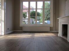 Nieuw gelegde eikenhoutenvloer afgewerkt met Vestingh VloerOlie. Door Vestingh