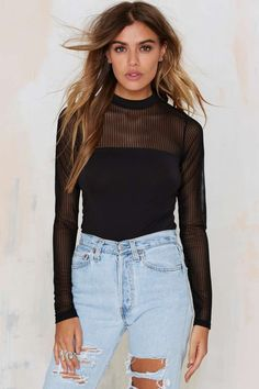 Wondering how to carry that sheer panel trend over into fall? With this black knit mock neck top of course!