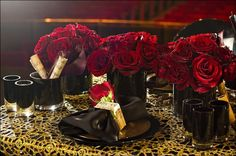 This gorgeous Phantom of the Opera themed wedding shoot channels the play's simultanous creep-and-romance factors. Dark settings are mysteriously spooky while red roses and gold overlays create romantic opulence.