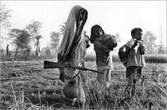A mother in Khulna, Bangladesh stands guard over her children while they venture out to collect food during the Bangladeshi War for Independence in 1971 East Pakistan, India And Pakistan, Bangladesh Travel, Bangladesh Flag, Rare Videos, History Of India, Vintage India, Historical Monuments, Rare Pictures