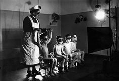 A nurse gives children of working mothers UV light treatments if their hair turned brown at a nursery in Berlin, Germany. Probably the most disturbing project the nurses of Nazi Germany assisted in was the Lebensborn Program, where scientists, on orders of Heinrich Himmler, attempted to breed an elite race of pure Aryans to lead the Third Reich. Under the horrific plan, children who didn't measure up were sent to concentration camps.