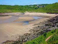 Manorbier beach overlooked by its beautiful castle. Great beach for surfing and rockpools.