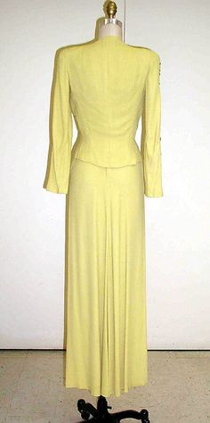 Elsa Schiaparelli evening ensemble 1937-1939 yellow embroidered dress gown, jacket and matching bag purse for Bonwit Teller & Co. (American, founded 1907) Department Store.