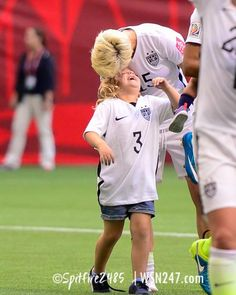 365fd8695c8 Megan Rapinoe gives Christie Rampone s daughter a smooch after the USA vs  Nigeria game at the