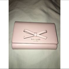 Kate Spade Wallet NWT, perfect condition. Comes with the box and price tag. Beautiful wallet, tons of slots for your cards and plenty of room for cash and other goodies  kate spade Bags Wallets