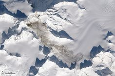 Scientists have confirmed that the largest known landslide on Earth since 2010 occurred on the flanks of Mt. La Perouse in southeastern Alaska on 2/16/2014. NASA Earth Observatory image: Jesse Allen, Robert Simmon