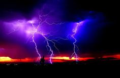 Black clouds appear in a distant sky a great storm rages. Thunder rolls lightning flashes, things blow away.
