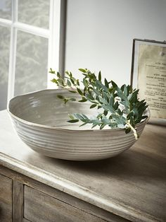 Crafted from fine ceramic with a rustic, white glazed finish and pretty waved edge, our elegant fruit bowl will make a beautiful feature on your kitchen worktop or dining table. It's the perfect way to display your favourite fruit or other snacks.