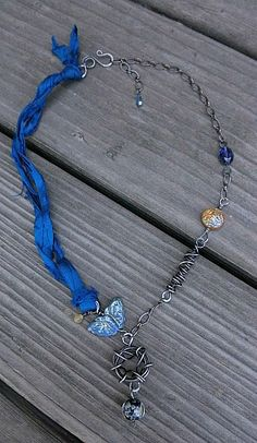 Use sari silk ribbon, cord and links.  Inspiration from http://freshbakeddesigns.wordpress.com/