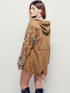 Golden Quills Military Parka | Distressed cargo jacket with beautiful stud and metallic embroidered embellishment on sleeves. Drawstring ties at front of neckline, bottom front, front of waist and at lower back hem. Zipper opening in front. Four front zipper pockets. Hooded. Lined.