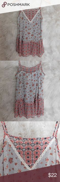 American Rag Tank Floral American Rag Tank. Pair it with white jeans and sandals! Recommended to wear a bandeau or tank underneath. Perfect condition, has no wear or tear. American Rag Tops Tank Tops