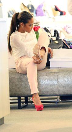 Christina Milian pink pumps light pink pants white sheer top blue nails