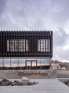 Klimatorium is a landmark climate centre in a Danish harbour Cultural Architecture, Facade Architecture, Amazing Architecture, Door Sets, Natural Scenery, Boat Building, Storm Surge, Ground Floor, Pavilion