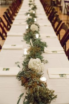 Greenery wedding reception decor idea - greenery table runner with hydrangeas and candles {JOPHOTO}