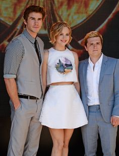 Liam Hemsworth, Jennifer Lawrence and Josh Hutcherson attend the 2014 Cannes Film Festival photocall for The Hunger Games: #Mockingjay Part 1. (Photo by David M. Benett)