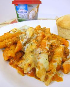 Baked Penne with cream cheese & sausage   1/2 lb. extra-lean ground beef or Italian Sausage 1/2 cup chopped onions  1/2 cup green peppers  1 jar(24 oz.) spaghetti sauce 1 tub(10 oz.) Philadelphia Italian Cheese and Herb Cooking Creme, divided (I used reduced fat) 1 cup Kraft Shredded Mozzarella Cheese, divided 3 cups cooked penne pasta