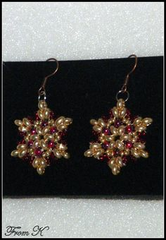 """#Star pattern bead woven #holiday #earrings. Sophisticated color combo of gold and rose red. Made with Czech glass beads and special """"twin"""" beads. (""""twin"""" bead is the latest trend in beaded jewelry). About 4,5cm long 15.00 Ron  For more photos, prices and other info, please visit my facebook page https://www.facebook.com/BeadsFromK/photos/"""