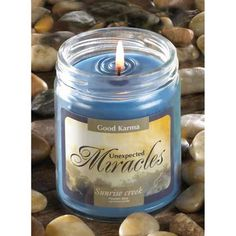 "Good Karma Unexpected Miracles Candle (Item #14217)  A cheering blend of spring flowers brings to mind life's little miracles, and sets the scene for karmic discovery! This candle inspires happy reflection and opens your heart to every blessing that is sure to come your way. Heavenly mist fragrance. 7 oz. jar. Burns up to 50 hours. Made in USA. Item Weight: 0.8 lb. 2¾"" diameter x 3½"" high. Soy blend wax with lidded glass jar."
