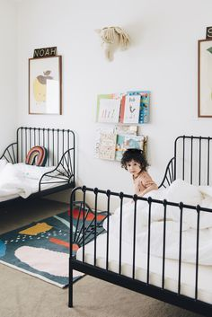 IKEA black metal beds in kids room