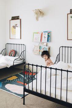 IKEA black metal beds in kids room