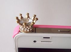 Keep dust out of your iPod, iPhone, smart phone and most cell phone's earphone jack.  Easy to be installed and removed.  This listing is for one (1) BLING Crown.  This little crown has crystal clear rhinestones all the way around it and a large crystal clear glass in the center.  $8.00