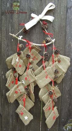Advent calendar from hessian, pine cones and a twig. Simply charming! Christmas