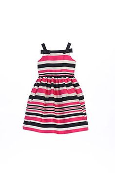 Elegant sleeveless striped organza dress with shoulder bows. This feminine style is one that your little one can wear to so many events. This is sure to be a closest staple this season. You can dress up or down to your liking. This dress is made from a designer label that upholds to the highest in quality and super cute style and value. This dress is fully lined and has a zipper closure. Proudly made in the USA. So incredibly fun and festive-do not miss out on this dress!