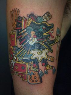 A tribal Aztec tattoo design of Xolotl, the Aztec god of fire and death. Xolotl would often be painted or carved on or around temples, as he was the deity who transported souls into the afterlife. He is mostly shown as a dog-headed man or a man-beast with reversed feet. The colors used in this tattoo were typical of Aztec paintings and art.
