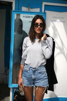 cat eye sunglasses, red lips, grey sweatshirt, cut off denim shorts & top handle bag #style #fashion #jeans #summerstyle