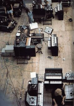 Edgar Froese (bottom) - leader and keyboard wizard  of German art and ambient rock group, Tangerine Dream. (Shown here in synthesizer studio.)