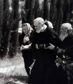 .Maria Pompilio walking with Padre Pio ad another friar