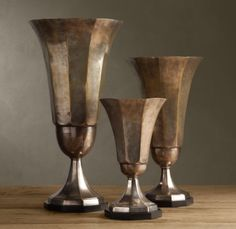 donna  Trophy Cups  Price: $99.00 | Visit Store »  I love to display a grouping of ordinary objects (like makeup brushes) in a vintage container. I'd especially like to use an antique sugar or creamer, a baby cup or one of these reproduction trophy cups from Restoration Hardware.