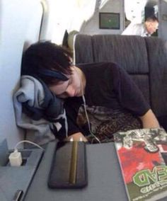 Michael Clifford sleeping.>>HE HAS A WALKING DEAD BOOK IM DYING HERE
