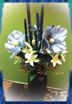 Handmade artificial floral arrangement with matching swag. Warm blue colors set in a navy blue vase  www.etsy.com/shop/kshandmadeflorals SOLD by kshandmadeflorals