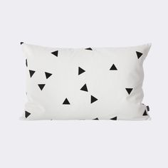 Triangles dance around our Mini Triangle Pillow, a fun pop to your bed or sofa. Layer with solid colors to set the foundation for the design.