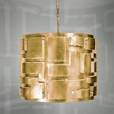 """Metal Cut Out Chandelier With its strong structural metal feel and raw cut outs this pendant truly defines the modern urban aesthetic, what is fundamentally rugged and edgy is refined into a sophisticated and stylish design by the addition a Silver champagne leaf or a Gold leaf finish.  3-40 watt candle base bulbs.  (20""""Hx26""""W)"""
