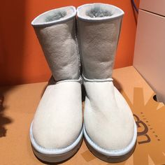 Short light blue Uggs Brand new size 9 light blue Uggs UGG Shoes Winter & Rain Boots