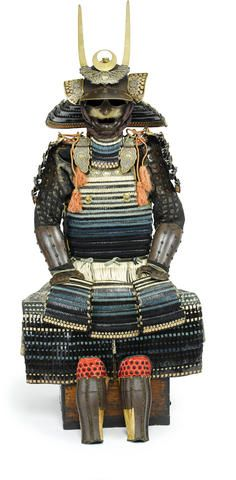 A black lacquer armor Edo period (late 18th century) Laced in white, blue and green with orange highlights and comprising a sixty-four plate russet-iron suji kabuto adorned with a five-stage gilt-copper tehen kanamono, the mabizashi and fukigaeshi edged with gilt-copper fukurin carved with scrolling vines, the bowl fitted with a five-lame shikoro with stenciled leather and silvered bamboo heraldic crests applied to the fukugaeshi, the maedate a circular gilt-copper bamboo-leaf heraldic crest