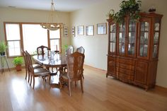 The formal dining room with windows looking out to the back yard.
