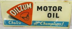 Sign for Oilzum Motor Oil. Choice of Champions is stated along the bottom.