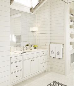 Leonine linens, white wood walls, bathroom, via @collins_interiors