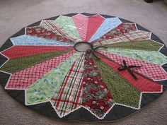This would be cool using neck ties of a loved one. Xmas Tree Skirts, Christmas Tree Skirts Patterns, Diy Christmas Tree Skirt, Fabric Christmas Trees, Christmas Tree Ornaments, Christmas Decorations, Christmas Ties, Christmas Quilting, Crochet Christmas