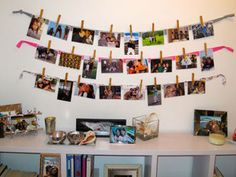 A great way to hang photos in dorms! Materials needed: photos, string/ribbon, clothespins, command strips/tape