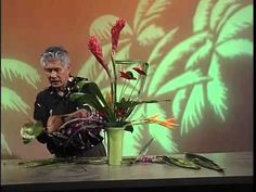 Floral designer Phil Rulloda demonstrates how to make several fresh flower arrangements featuring tropical flowers and foliage from Hawaii. Floral designs with exotic Hawaiian flowers.