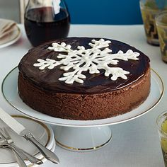 Chocolate Truffle Cheesecake | Let this elegant chocolate cheesecake be the centerpiece of your holiday tablescape featuring a gorgeous White Chocolate Snowflake in the center.