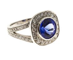 Round Tanzanite Diamond Platinum Ring   From a unique collection of vintage fashion rings at https://www.1stdibs.com/jewelry/rings/fashion-rings/